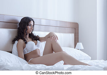 Beautiful  brunette woman in bedroom