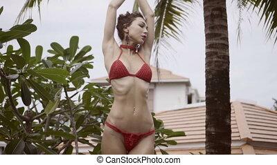 Beautiful brunette woman in crochet bikini