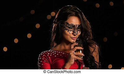 Beautiful brunette woman in glass of champagne. Slow motion...