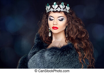 Beautiful brunette woman in mink fur coat. Jewelry. Fashion Beau