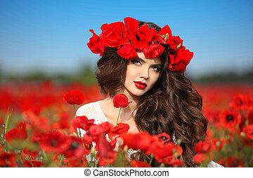 Beautiful brunette woman in poppies field with flowers, attractive teen girl