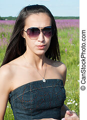 Beautiful brunette woman in sunglases