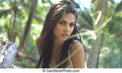 Beautiful brunette woman in the jungle