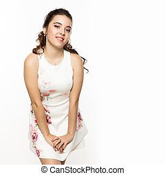 Beautiful brunette woman in white dress on white background. Free space for your text