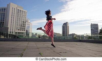 Beautiful brunette woman is dancing in slow motion