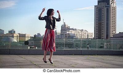 Beautiful brunette woman is jumping in slow motion