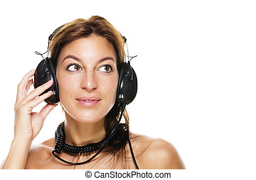 beautiful brunette woman listening to music on white background