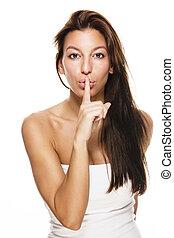 beautiful brunette woman making shush sign on white background