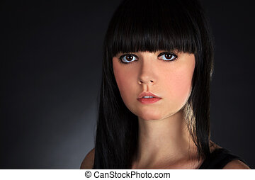 Beautiful Brunette Woman Portrait over Dark Background
