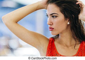 Beautiful brunette woman posing