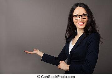 beautiful brunette woman presenting copyspace