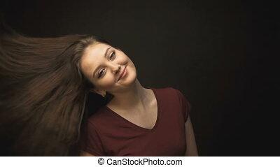 Beautiful brunette woman shaking head