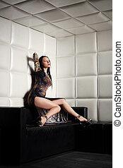 Beautiful brunette woman sitting in nightclub
