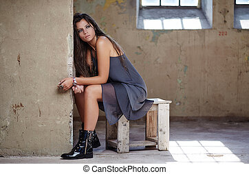Beautiful brunette woman sitting on chair