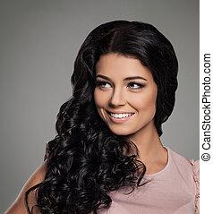 Beautiful Brunette Woman Smiling. Portrait