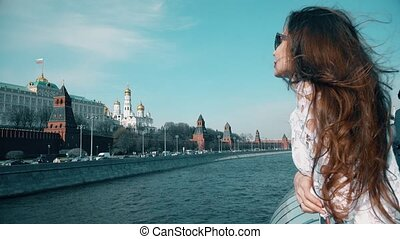 Beautiful brunette woman watching at Moscow Kremlin. Travel to Russia concept. 4K clip