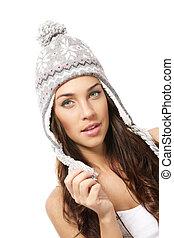 beautiful brunette woman wearing winter cap on white background