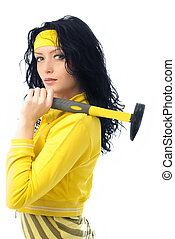 beautiful brunette woman with a hammer