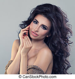 Beautiful Brunette Woman with Curly Hairstyle and Makeup. Beautiful Model with Permed Hair