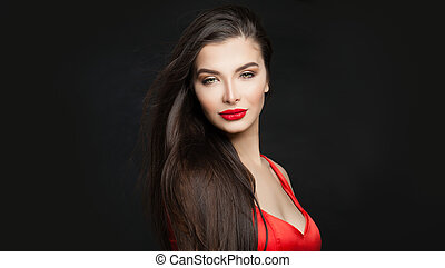 Beautiful brunette woman with long hair and red lips makeup, portrait. Perfect fashion model on black background