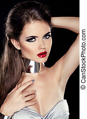 Beautiful Brunette Woman with Red lips isolated on black background. Fashion Beauty Girl.
