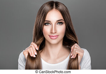 woman with shiny straight long hair.