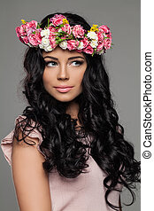 Beautiful Brunette Woman with Summer Flowers on her Head