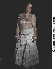 Beautiful brunette woman with white dress, sensuality
