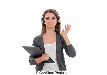 beautiful brunette woman working in call center with headphones and microphone posing on camera isolated on white background
