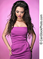Beautiful brunette young woman over pink