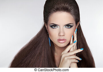 Beautiful Brunette young woman with fashion earring. Makeup....