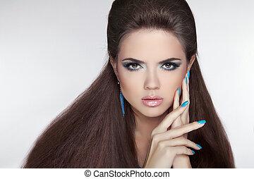 Beautiful Brunette young woman with fashion earring. Makeup. Ma