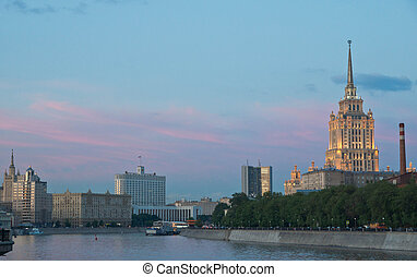 beautiful buildings on banks of the river at sunset
