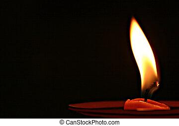 Beautiful burning candle isolated on black background
