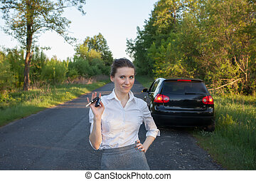 girl with car key in hand