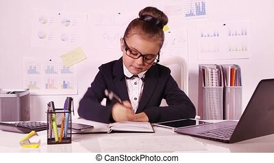 Beautiful business girl working at the office