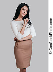 Beautiful business lady. Gorgeous young woman in smart...
