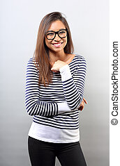 Beautiful business latina woman in glasses toothy smile with folded arms on empty copy space background.