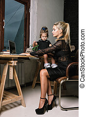 Beautiful business mother with her little girl.