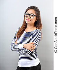 Beautiful business positive woman in glasses looking with thinking look on empty space background.