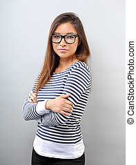 Beautiful business serious woman in glasses looking with thinking look on empty space background.