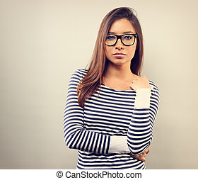 Beautiful business serious woman in glasses looking with thinking look on empty space background. Toned vintage portrait