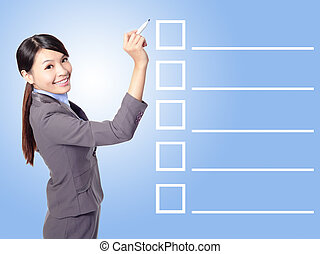 business woman Filling Check list - Beautiful business woman...
