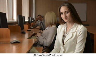 Beautiful business woman in a light suit. Brunette in a...