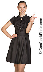 Beautiful business woman in black dress pointing at copy space
