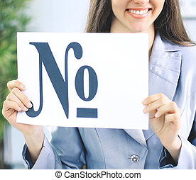 Beautiful business woman in office holding a sign with the number sign