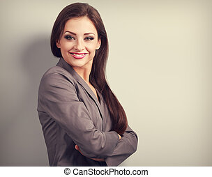 Beautiful business woman in suit smiling on empty copy space background. Toned portrait