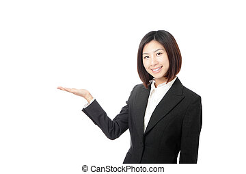 Beautiful Business woman introducing something by hand