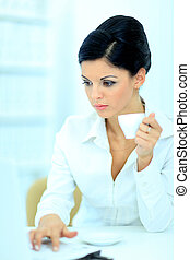 Beautiful business woman is working in office