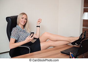 Beautiful business woman relaxing in her office